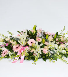 Our elegant casket spray is a beautiful and intricate display of in season flowers to pay tribute to a life that was well lived. Available in a variety of colours and style.