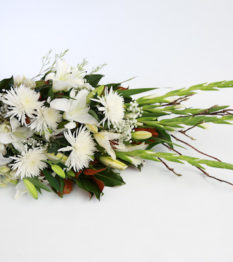 Tribute Sheaf of subtle and muted tones for the service.