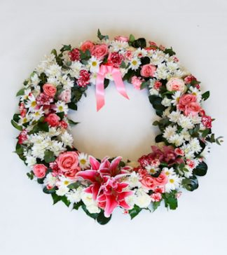 Our wreath, adorned with a graceful composition of seasonal flowers for the service, is a wonderful way to express your feelings for a friend or loved one.